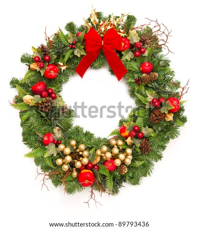 christmas wreath with red ribbon and golden decoration isolated on white