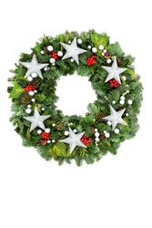 Christmas wreath with silver star & ball bauble decorations with spruce fir, winter berry holly, cedar, mistletoe, acorns & ivy on white background. Festive composition for the holiday season.