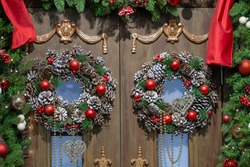Christmas wreaths and decoration on the doors of the house