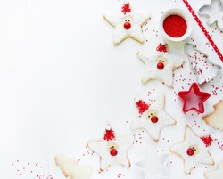 Christmas Xmas New Year baking concept with cute holiday santa cookies and red sugar decorations on white background copyspace