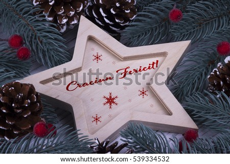 Christmas Xmas New Year Holiday greeting card with wooden five pointed star fir branches cones and text Craciun Fericit  Imagine de stoc ©