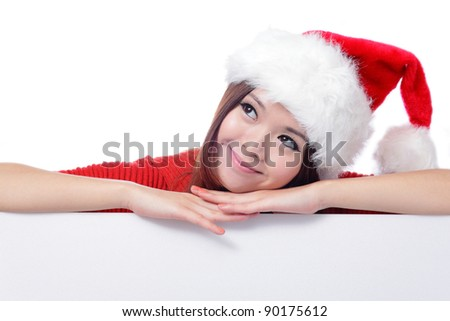 christmas young girl looking up and thinking with blank billboard banner sign. Beautiful and cute Asian female model Isolated on white background
