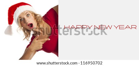 Christmas young sexy woman happy smiling and holding empty banner, isolated on white background