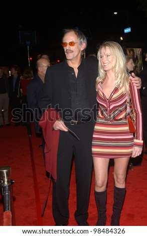 CHRISTOPHER LLOYD & wife at the USA premiere of The Lord of the Rings: The Return of the King, in Los Angeles. December 3, 2003  Paul Smith / Featureflash