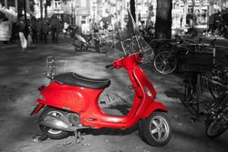 chroma key picture of a red scooter in in the city with a black and white surrounding
