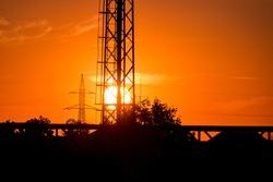 chromatic sky, sunset seen between bars