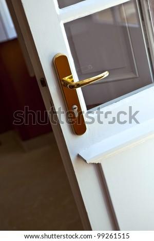 Chrome door handle on the front door of a house - stock photo