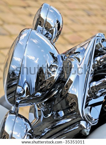 Chrome headlights from a motorcycle.