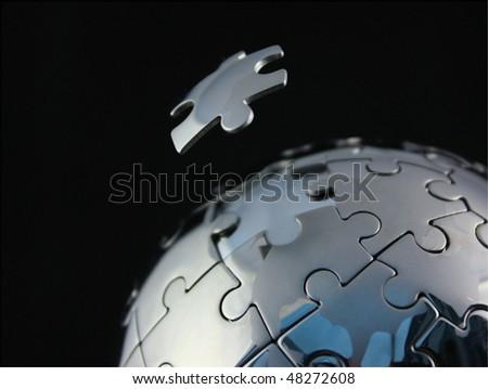 Chrome jigsaw globe with floating piece