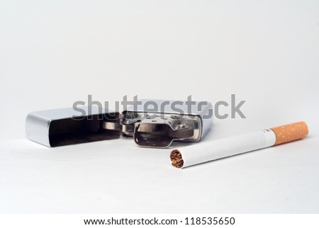 Chrome lighter with cigarette close up, isolated on white