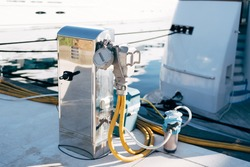Chrome plated cabinet for marina refueling and water replenishment. Refueling and charging of yachts.