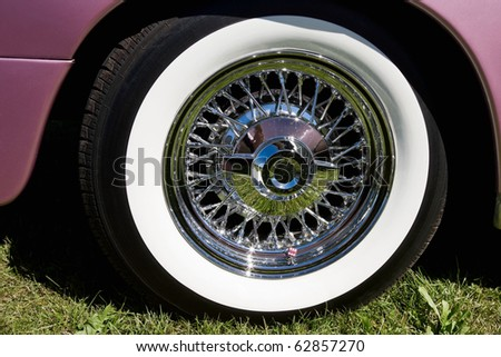 Chrome rims with whitewall tire