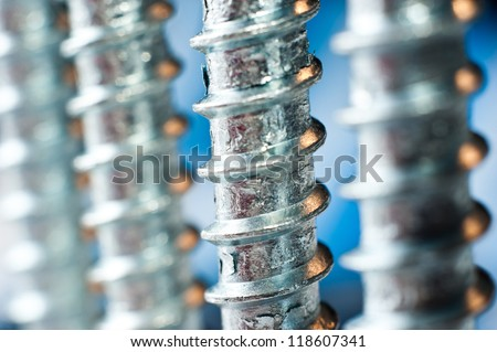 chrome screw on a blur blue background