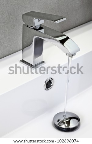 chrome tap in modern bathroom