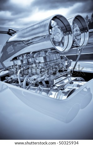 chromed engine supercharger on a performance race car