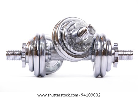 Chromed fitness dumbbell isolated on a white background