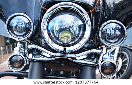 Chromed motorcycle headlights. #1287377764