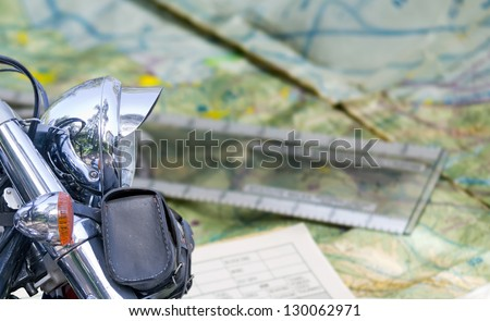 chromed motorcycle with road map on the background