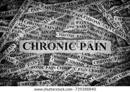 Chronic Pain. Torn pieces of paper with the words Chronic Pain. Concept Image. Black and White. Closeup.
