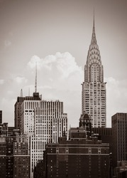 Chrysler Building. The Chrysler Building is an Art Deco-style skyscraper located on the East Side of Midtown Manhattan in New York City. Old photo stylization, film grain added. Sepia toned