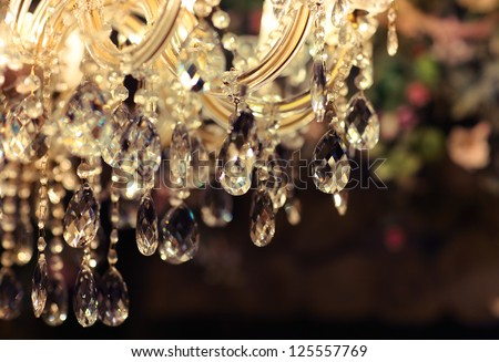 Chrystal chandelier close-up. Glamour background with copy space - Shutterstock ID 125557769