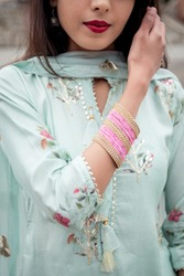 Chudiyan. Bracelets on the girl's hands. Traditional accessories of Indian girls. Girl in traditional Indian clothing, salwar kameez.