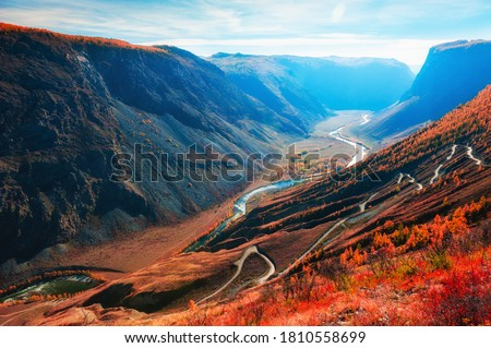Photo of  Chulyshman river gorge and view of Katu-Yaryk pass in Altai mountains, Siberia, Russia. Beautiful autumn landscape at sunrise