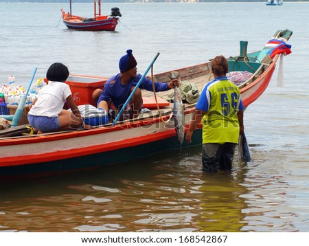 CHUMPHON, THAILAND - SEPTEMBER 22 : Unidentified fishermen carry fish to keep on the cart on September 22, 2012 at Chumphon Thailand
