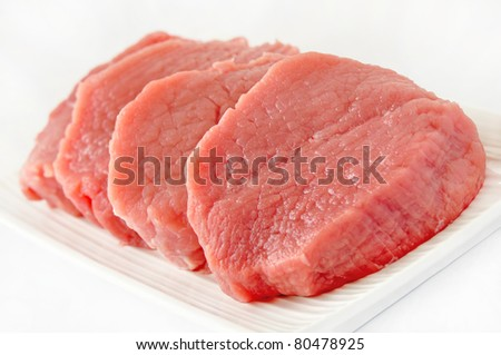 Chunks of beef meat isolated on white background
