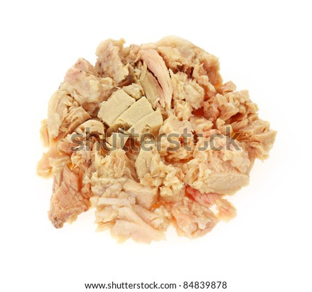 Chunks of canned albacore tuna on a white background.