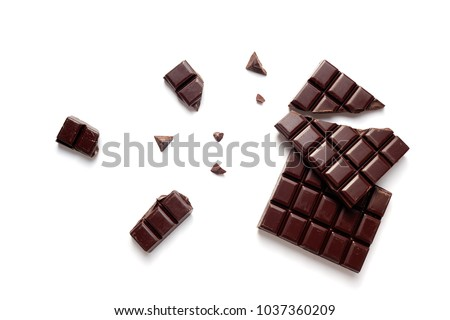 Chunks of Dark Chocolate On White Background. #1037360209