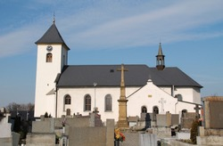 church and some crosses on the cemetery in Albrechticky, Czech Republic