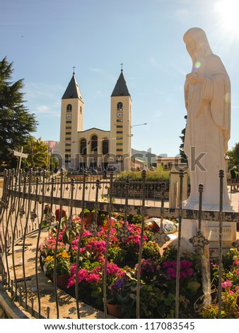 church and statue of Madonna in Medjugorje, a place of pilgrimage from all over the world in Bosnia and Hercegowinie - stock photo