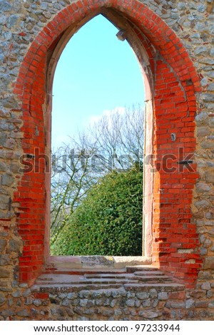 church arch way with rural view - stock photo