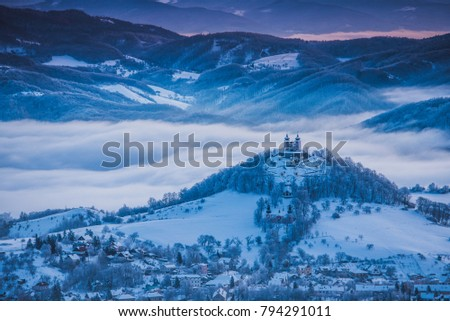 Church at the top of the hill in calm blue  winter morning. Banska Stiavnica, Slovakia #794291011