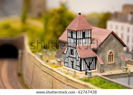 church building and graveyard in a miniature model village