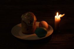 church candle and easter stand on an old wooden table on quarantine easter day