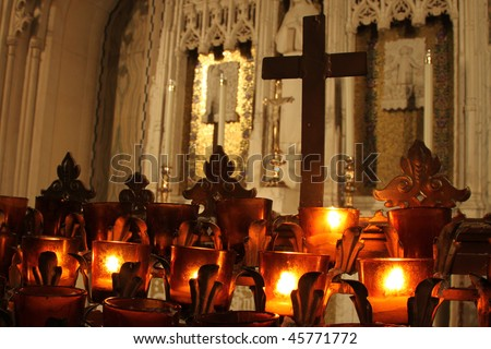 church candles in front of altar