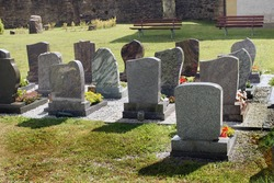 church cemetery with  graves in europe