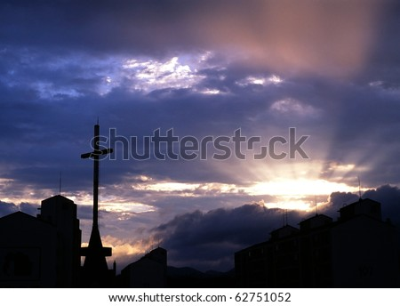Church cross in the last light of day