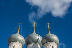 Church domes with crosses on a bright background of blue sky.