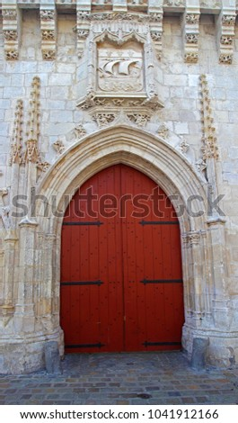 Church door entrance with wood door and stone arch