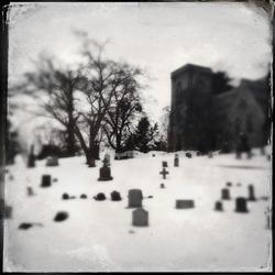 Church graveyard in winter tintype