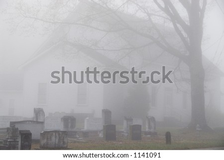 Church Graveyard on a foggy morning - stock photo