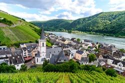 Church, houses and vineyards in Assmannshausen. Upper middle Rhine river valley (Mittelrhein), nearby Rudesheim am Rhein, Lorch. Hessen, Germany. Unesco