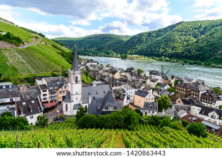 Church, houses and vineyards in Assmanshausen. Upper middle Rhine river valley (Mittelrhein), nearby Rudesheim am Rhein, Lorch. Hessen, Germany. Unesco