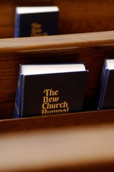 Church hymnals in pew
