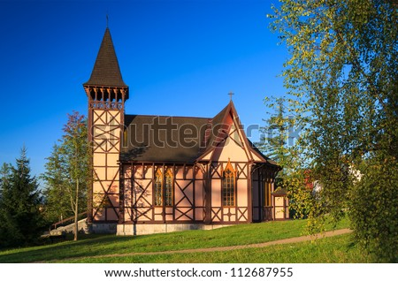 Church in early light of sunrise in mountain village of Stary Smokovec, High Tatras, Slovakia