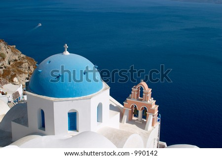 Church in Oia Santorini in front of the Mediterranian sea