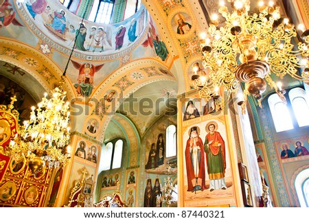church interior with ceiling, chandelier and icons